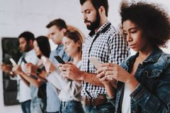 Busy. Not Pay Attention. Young People.Stand. Line. royalty free stock photography