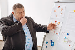 Busy office clerk working on a plan Stock Image