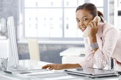 Busy office girl on phone Stock Images