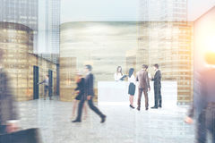 Busy office. People are walking, entering doors in a corridor, talking and discussing work issues. Stock Image