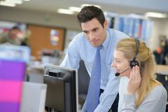 A busy office scene. Office Royalty Free Stock Photography