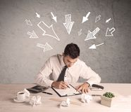 Busy office worker with drawn arrows Stock Photography