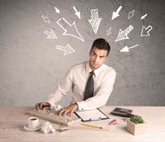 Busy office worker with drawn arrows Royalty Free Stock Image