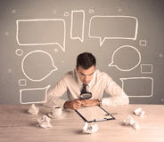 Busy office worker with drawn text bubbles Royalty Free Stock Photos