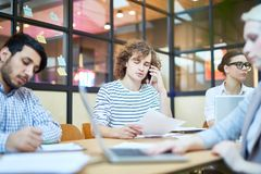 Busy office workers Royalty Free Stock Image