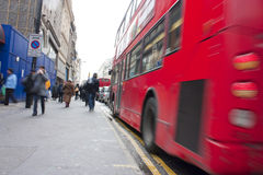 Busy oxford street. In london including a moving red bus and people Stock Photography