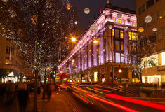 Busy Oxford Street, Christmas shoppers, traffic, and Selfridges. Royalty Free Stock Images