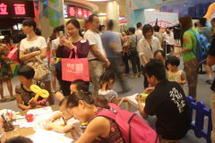 The busy parent-child activities in Shenzhen Tai Koo Shing Shopping Center Stock Photography
