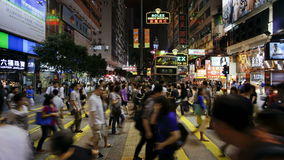 Busy pedestrian crossing on nathan road kowloon hong kong china t lapse stock video
