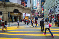 Busy pedestrians crossing street in HK Royalty Free Stock Images