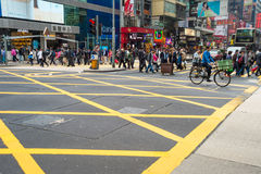 Busy pedestrians crossing street in HK Stock Images