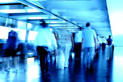 Busy people in blured motion Royalty Free Stock Photo