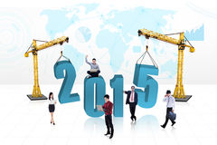 Busy people with number 2015 Royalty Free Stock Photo