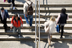 Busy people subway. Busy people on subway station steps abstract motion blur. Daily life urban street scene Royalty Free Stock Images