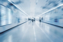 Busy people in tunnel blue tone Stock Images