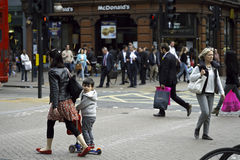 Busy people walking in london. Business people and tourists walking and shopping Stock Photo
