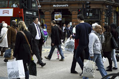 Busy people walking in london. Business people and tourists walking and shopping Royalty Free Stock Image
