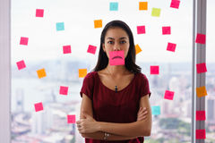 Busy Person Holds Sticky Note On Mouth With Emoticon Stock Photography