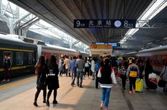 Busy platform with passengers exiting trains and greeting at Beijing Railway Station China Royalty Free Stock Photo