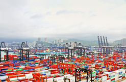 Busy port in the morning in Hong Kong from bird view. It is one of the busiest ports in the world, in the three categories of shipping movements, cargo handled Stock Photos
