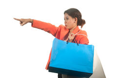 Young Asian business woman with shopping bags isolated on a whi Royalty Free Stock Image