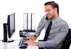 Busy professional using telephone while at work Stock Image