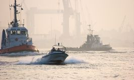 Busy on the river. Very busy with ships on the river at sunrise Stock Image