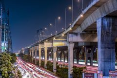 The busy road at Bangna, Thailand. This photo was taken on a bridge at Bangna-Trad main road, Bangkok. The volume of cars and heavy congestion created the messy Stock Image