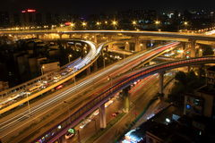 The busy road interchanges at night Stock Images
