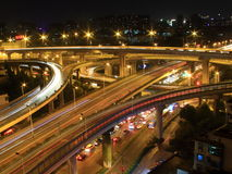 The busy road interchanges at night Stock Image