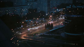 Busy road at night in the city. Top perspective timelapse shot, vehicles rush in both directions, motion blur rendering