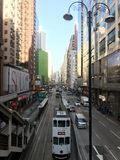 Busy Road in North Point, Hong Kong. This photo was taken at a footbridge at King's Road, one of the busy corridors in Hong Kong. Trams, buses and other Royalty Free Stock Photos