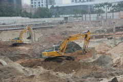 Busy running excavator At the site in SHENZHEN Stock Image