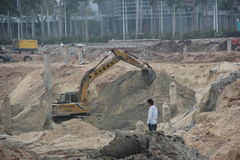 Busy running excavator At the site in SHENZHEN Stock Photography