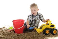 Busy with Sand and Toys Stock Image