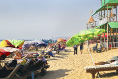 Busy sandy beach scene Goa India Stock Image