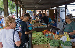 Busy Saturday at the Salem Farmers Market. Salem, VA – July 27th: Busy Saturday with many shoppers at the Salem Farmers Market located on Main street downtown Royalty Free Stock Image