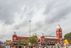 Busy scene in front of famous ancient railway station,vehicles pass by traffic signal,people are waiting to cross the road Stock Photography