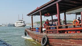 Busy scenery view of harbour in Halong Bay, boats can seen fetching tourists to the cruises. stock video footage
