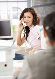 Busy Secretary Talking On Phone In Office Smiling Stock Images