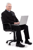Busy senior business man sitting in chair Stock Images