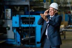 Busy Senior Entrepreneur Using Smartphone Stock Photos