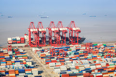 A busy shipping and port machinery background. Closeup of the container terminal, a busy shipping and port machinery background Royalty Free Stock Photo
