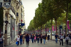 Busy shoppers along the stores of Champ Elysees in Paris Royalty Free Stock Images