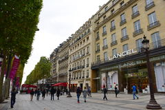 Busy shoppers along the stores of Champ Elysees in Paris. PARIS - SEPTEMBER 24: Busy shoppers along the stores of Champ Elysees, taken on September 24, 2014 in royalty free stock image