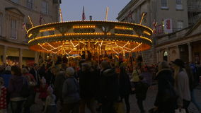 Busy shoppers with Carousel in background stock footage