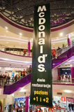 Busy shopping mall. Big Mc Donalds sign in the busy Poznan City Center shopping mall in Poznan, Poland Stock Photos