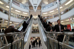 Busy shopping mall. Customers are shopping in busy mall in London, UK Stock Photo