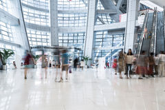 Busy shopping mall. Long exposure time, shoppers moving are deliberately blurred Royalty Free Stock Photo