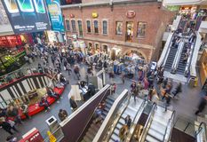 Busy shopping mall. Melbourne, Australia - Aug 1, 2015: People visiting Melbourne Central, which is a complex with shopping mall, office tower and railway Royalty Free Stock Photos
